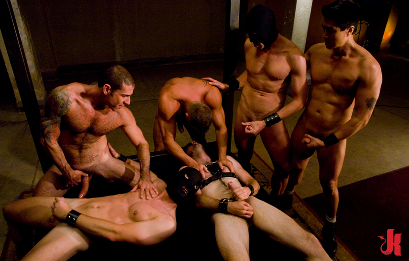 Gay sex slaves lying on their back and fucked in the mouth in group gay sex
