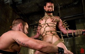 Gagged and tied up gay man gets his body covered in clothes pins in bondage sex