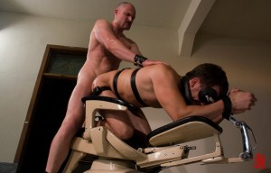 Gorgeous gay slave is fucked in the ass on a dentist's chair by his Master in extreme bondage