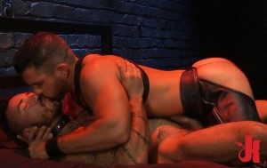 Master and gay slave have a moment of tenderness and kiss each other on the bed