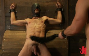 Chained and masked male slave gets his torso flogged by a dominant and gay man