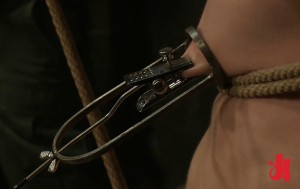 Gay slave is tied up, humiliated and has his nipples bound in some sort of torture device