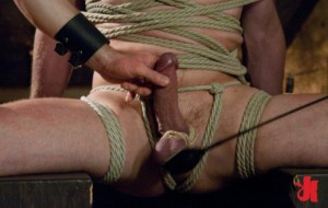 Gay man gets tied up with rope and has his dick tortured with it and a riding crop by a man